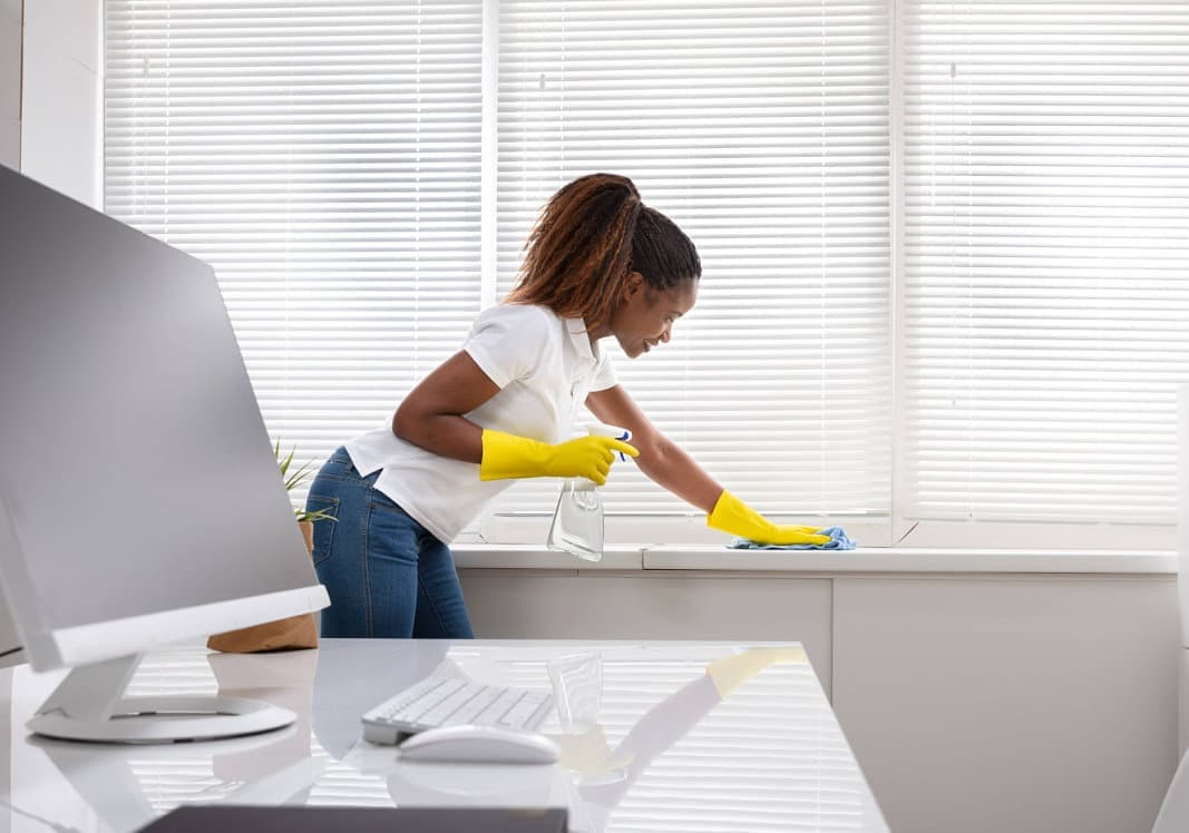 woman cleaning the office