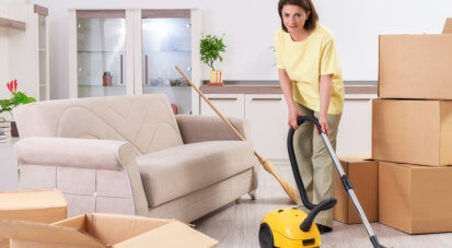woman cleaning the living room