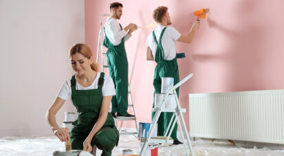people painting the room