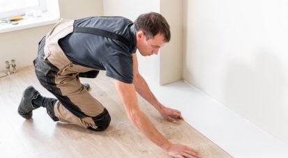 man installing room floors