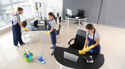 cleaners cleaning the office