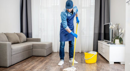 man cleaning the house