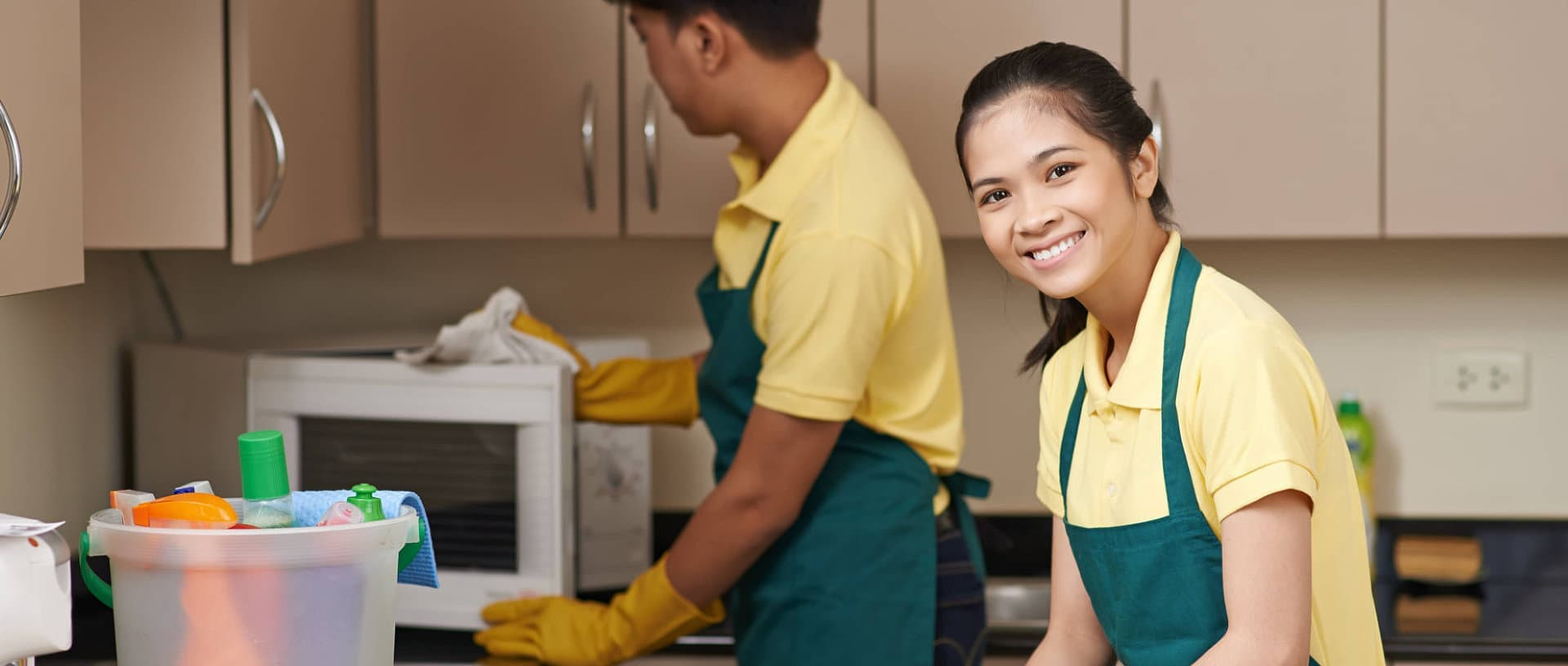 smiling woman cleaning the kitchen