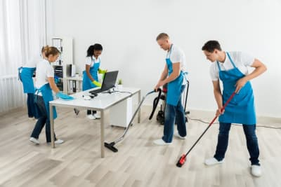 group of janitors cleaning office