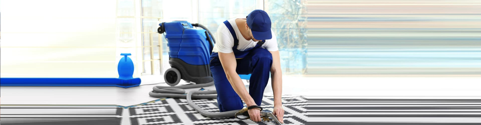 man cleaning the floor mat
