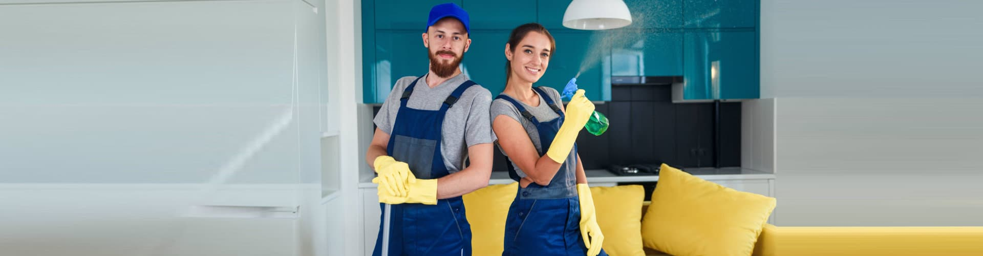 happy male and female cleaners